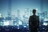 Fototapeta Miasto - businessman looking to city