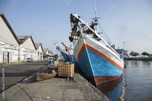 Staande foto Indonesië Attractive blue colorful fishing boats in Indonesia