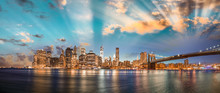 Dramatic Sky Over Brooklyn Bridge And Manhattan, Panoramic Night