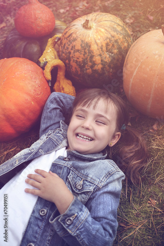 Poster Crimson The girl in a jeans jacket in a forest in autumn day