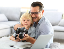 Man With Little Boy Playing Wi...