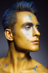 Fashion portrait of man with artistic make-up