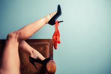 Seductive Woman In Heels On Sofa