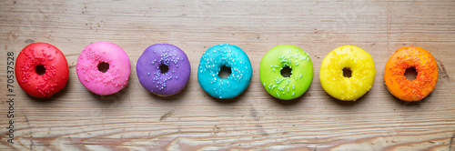 Photo  Row of colorful donuts
