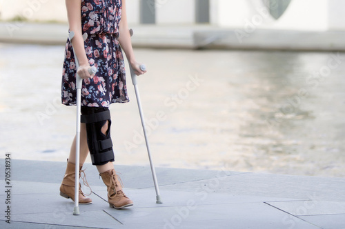 close up of woman with crutches Fototapete