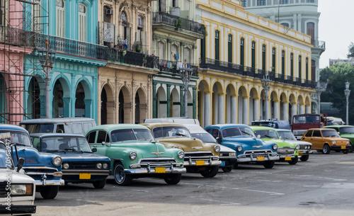 Poster Havana Street scene with vintage car in Havana, Cuba.