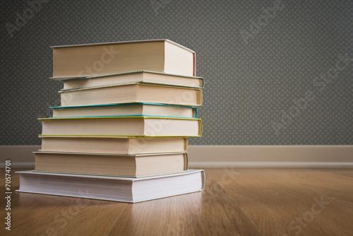 Fotografie, Obraz  Stack of books on the floor