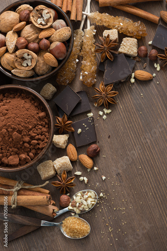 Foto op Plexiglas Chocolade cocoa, chocolate, nuts and spices on wooden background, vertical