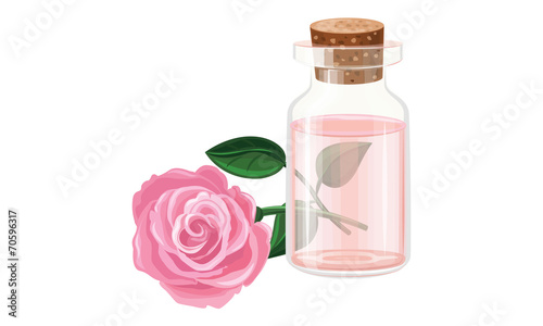 Rose oil in a glass bottle