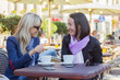 canvas print picture - Two female friends meeting for a coffee