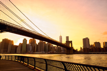 Sunset view Manhattan skyline with Brooklyn Bridge in New York
