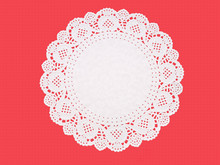 Fancy Paper Doily, Round, Perforated, Embossed, On Textured Red.