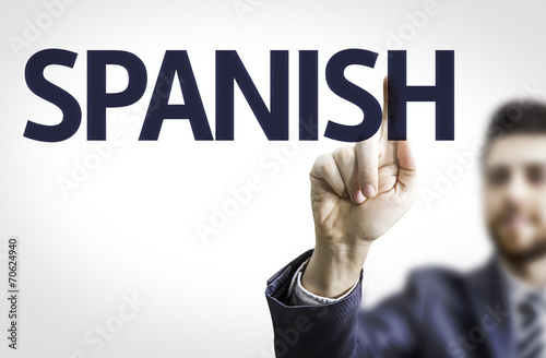 Foto  Business man pointing to transparent board with text: Spanish