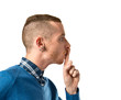 Man making silence gesture over isolated white background