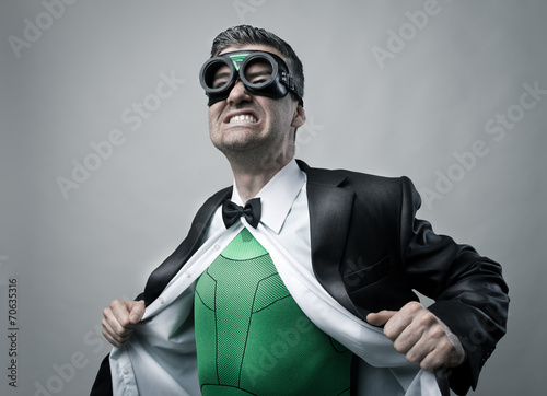 Superhero taking off shirt and jacket Plakat