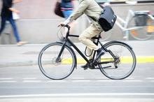 Man On Bike In Profile