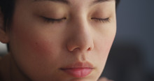 Close Up Of Chinese Woman Resting With Eyes Closed