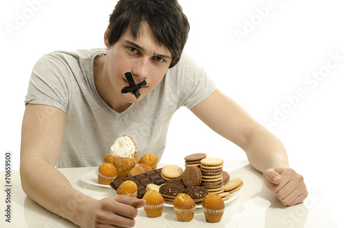 Valokuva Man in love with sweets, candies,chocolate and sugar, abstain