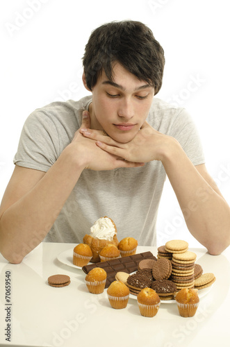 Photo  Man in love with sweets, candies,chocolate and sugar