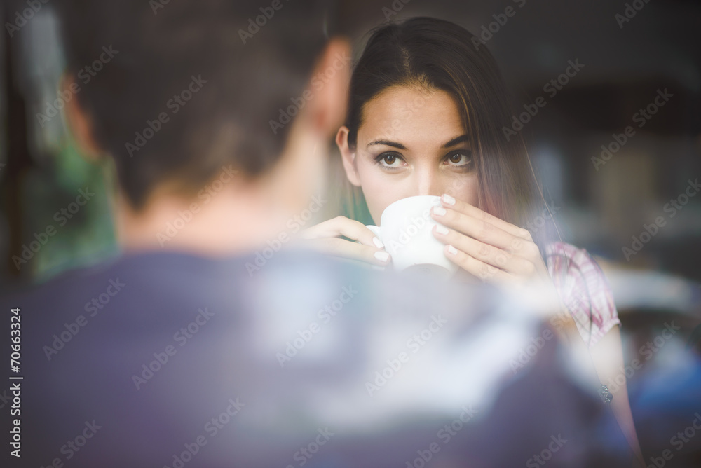 Fototapety, obrazy: Young couple on first date drinking coffee