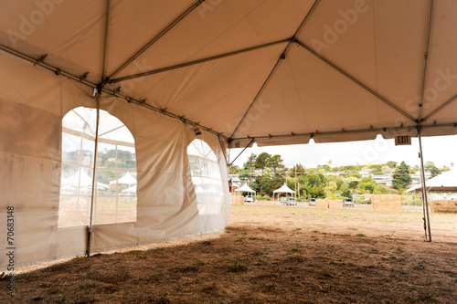Wall Murals Khaki White tents in a dry field outdoors