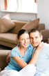 Young smiling attractive couple at home