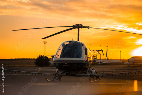 Canvas Prints Helicopter Helicopter waiting for takeoff at sunset