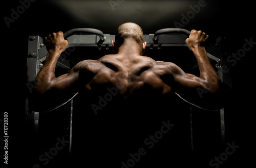 Bodybuilder doing pull ups Canvas Print