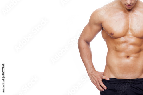 Photo Fit young man with beautiful torso, isolated on white background