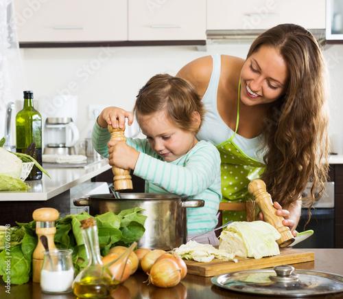 Fototapeta Happy family cooking  soup obraz