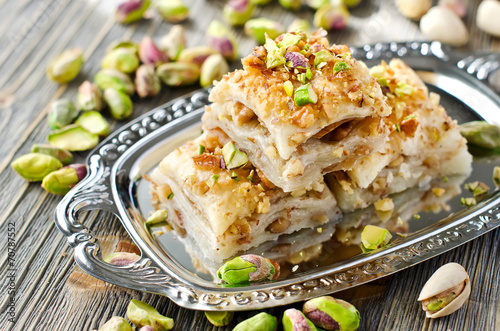 Foto op Plexiglas Dessert Turkish pistachio pastry dessert baklava with green pistachios