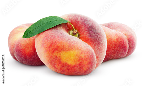 Three chinese flat donut peaches with leaf isolated on white