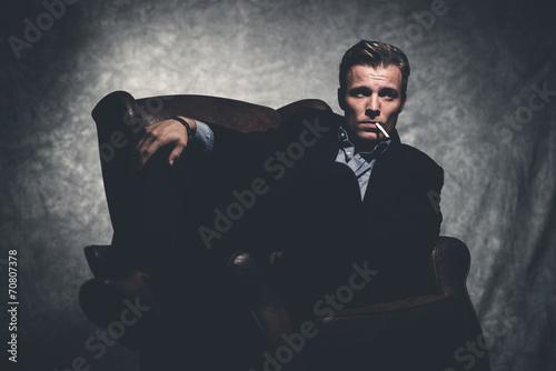 Fotografie, Obraz  Cigarette smoking retro fifties cool business fashion man wearin
