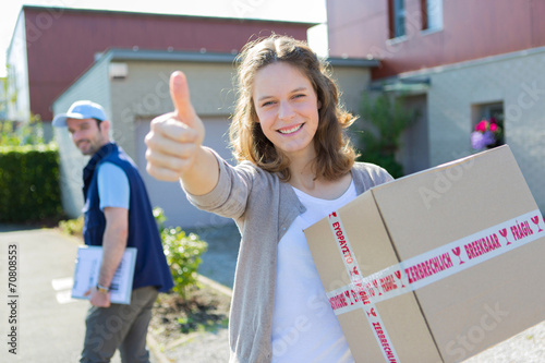 Fotografie, Obraz  Young attractive woman happy to receive parcel