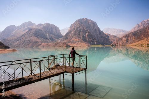 Spoed Foto op Canvas Blauwe hemel Girl relaxing near Iskanderkul lake, Tadjikistan.