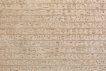Egyptian hieroglyphs stone background