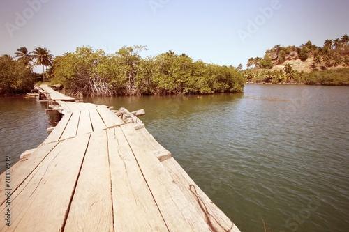 Cuba - footbridge in Baracoa. Cross processed retro color. Canvas Print
