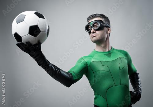 Fotografering  Superhero with soccer ball