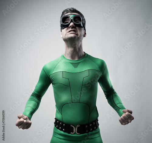 Fotografering  Funny superhero snarling