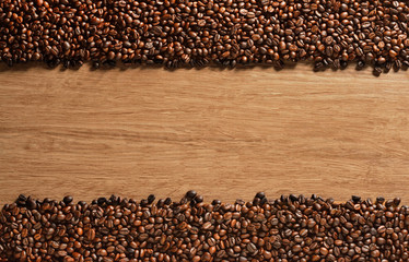 FototapetaTop view of coffee beans on old wooden background