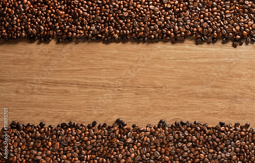 Top view of coffee beans on old wooden background - 70893705