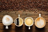 Fototapeta Kawa jest smaczna - Variety of cups of coffee and coffee beans on old wooden table