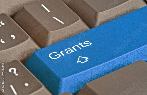 Fotografía  keyboard with key for grants