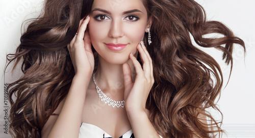 Beautiful fashion smiling girl model portrait. Long healthy Wavy