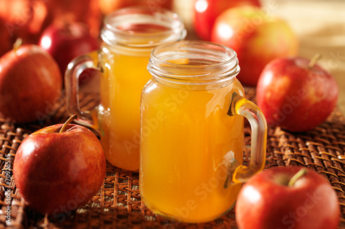 Canvas mason jars filled with hot apple cider
