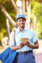 Mailman Walking Along Street D...
