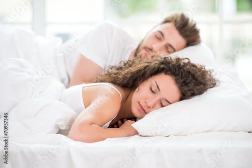Fototapeta Sleeping couple in the bed obraz na płótnie
