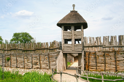 Photo  Palisade and entrance. The settlement in Biskupin.
