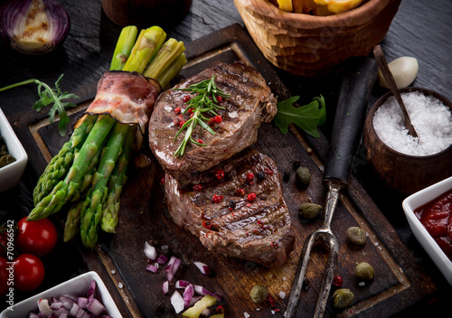 Beef steak on wooden table Canvas Print