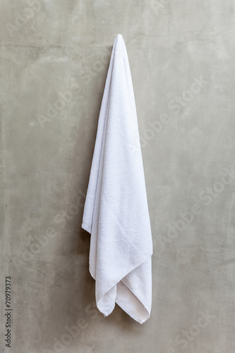 hanging white towel. Hanging White Towel Draped On Exposed Concrete Wall In The Bathr